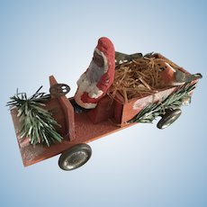 Father Christmas in wooden toy car novelty