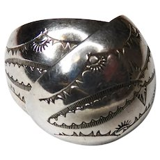 Sterling silver southwestern stamped earrings marked NEZ Navajo