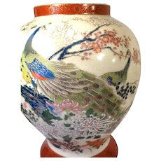 Chinese Porcelain Lidded Jar With Peacock, Cherry Blossoms, And A Plethora Of Flowers
