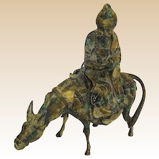 Iron Sculpture Of A Chinese Scholar On A Donkey