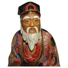Japanese Satsuma Gilt Hand Painted Pottery Seated Elder Figure.