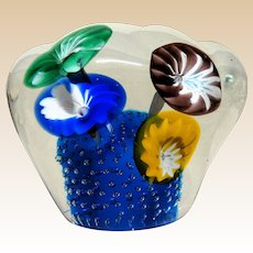 Four Flowers In A Large Paperweight That Burst With Color In A Cloud-Like Shape