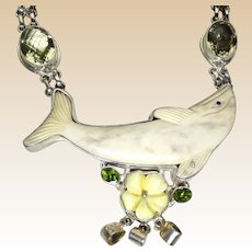 Dolphin, Flower and Faux Peridot Stones in a Large and Clunky Necklace
