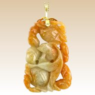 Chinese Carved Celadon to Russet JADE Pendant Necklace with 14 Karat Yellow Gold Chain.