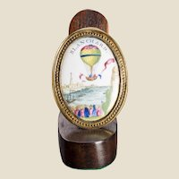 Painted Porcelain and Gilt Metal Drawer Pull With Ballooning Motif, Late 18th - Early 19th Century.