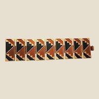 BEN AMUN Brushed Goldtone Bracelet With Brown and Black Cut Out Motif