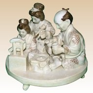 Porcelain Figural Group Of A Japanese Family, Signed - From the Birkhauser Estate