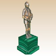 A Knight's Coat Of Armor (Metal) On Marble Base