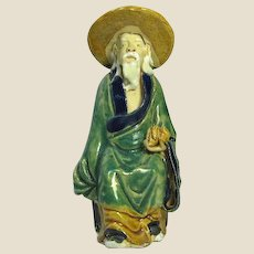 Chinese Mudman Seated Sage With  Peach (Symbol of Long Life) and Hat, Circa 1890 - 1919