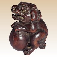 Carved Wood Japanese Netsuke Of Shi-Shi Lion Dog, circa 19th Century