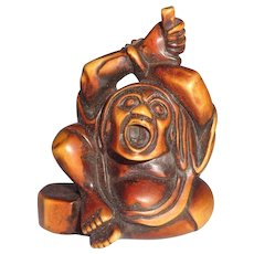 Signed Well-Carved Wood Netsuke Of Daruma Holding A Whisk Above His Head