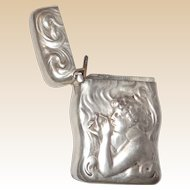 Unger Sterling Silver Shaped Match Safe (Vesta) With Repousse Decoration Of A Woman Lighting A Cigarette, Dated 1903