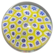 Spaced Millefiori Paperweight With Blue and White Canes On A Yellow Ground