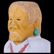 Johnson Antonio (Native American, b. 1931 - ) Wood Carving, Older Man in Blue Shirt With Moustache and Earrings