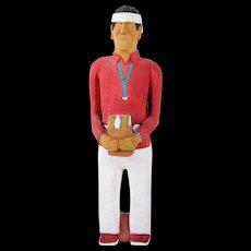 Johnson Antonio (Native American, Navajo, b. 1931 - ) Wood Carving, Man in Red Shirt Holding Bag Of Corn