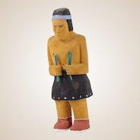 Johnson Antonio (Native American, Navajo, b. 1931 - ) Wood Carving, Shirtless Man in Traditional Dress Holding Grasses
