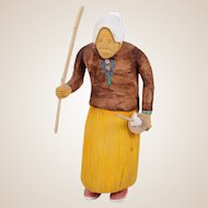 Johnson Antonio (Native American, Navajo, b. 1931 - ) Rare Wood Carving Of An Old Indian Woman Carrying Utensils