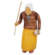 Johnson Antonio (Native American, Navajo, b. 1931 - ) Rare Wood Carving Of An Old Indian Woman Carrying Utensils