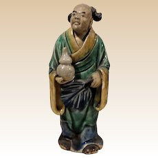 Unusual Chinese Standing Mudman With Bottle Gourd (Symbol of Longevity and Good Luck) and Palm Fan (Symbol of Authority)