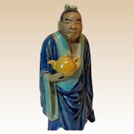 Chinese Standing Mudman With Teapot; Unusual Facial Features