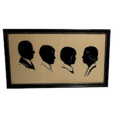 CYD CHARISSE Estate -  Framed Signed and Dated Cut-Paper Silhouette Of Ms. Charisse at 10 years old,  With Her Parents And Brother, Circa 1932