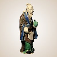 Chinese Mudman Standing Sage With Peach (For Longevity) and Fan (Symbol of Authority) - 6  1/2 inches tall.