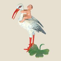 Adorable Miniature Stork With A Baby On His Back!