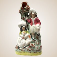 STAFFORDSHIRE Pottery  (England) - 19th Century Flat Back Spill vAse With Shepherd and Shepherdess (Holding Her Dog)