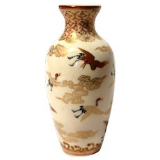 Japanese Signed Gilt and Hand-Painted Ceramic Miniature Vase With A Plethora of Different Birds And Unusual Rock Formations, Clouds, And Fabulous Borders