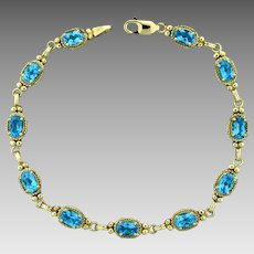 5 1/2ct TW Swiss Blue Topaz Bracelet in 10K Yellow Gold