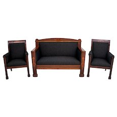 An elegant Empire style living room set after professional renovation, padded with new upholstery.