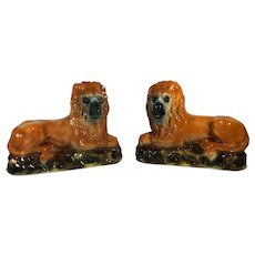 Pair of 19th Century Staffordshire Lions in Recumbent Position