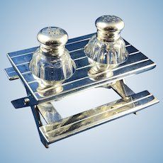Vintage Salt and Pepper Glass Shakers with Silver Plate Lids Set in a Silver Plate Picnic Table