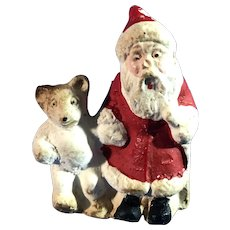 C. 1930 Santa Claus Chalkware Cake Topper with Toy Teddy Bear