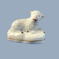 C.185-60 English Staffordshire Recumbent Lamb