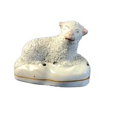 C.185-60 English Staffordshire Recumbent Lamb