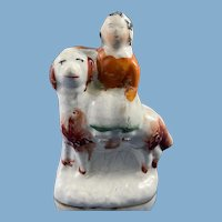 19th C. English Porcelain Figurine of a young Royal Youth Sitting on a Dog