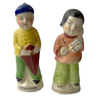 Vintage Chinese man and woman Salt and pepper shakers