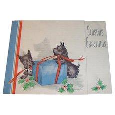 Vintage 1930s Seasons Greetings card with Scottie Dogs