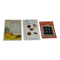 Lot of Buttons on three Cards