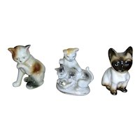 Three beautiful cat figurines