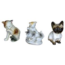 Three beautiful cat figurines