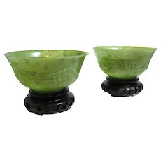 Pair of Vintage Chinese Spinach Jade Bowls with High Relief Reptiles on Wood Base