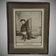 Vintage Photograph titled Rubber with Little Boy and Very Large Rubber Boot - 1910