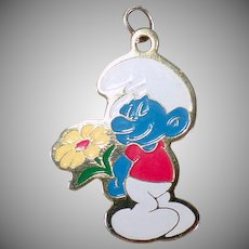 Vintage Smurf Charm or Pendant - 1980 Peyo Blue Smurf with Yellow Flower