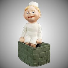 Vintage German Bisque Whimsy - Old Googly-eyed Child Sitting on a Basket