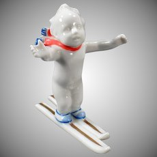 Vintage Germany Figurine -  White Porcelain - Frozen Skiing Baby - Very Funny