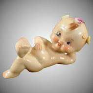 Vintage Porcelain Figurine - Reclined Kewpie-Like Baby with Flowers
