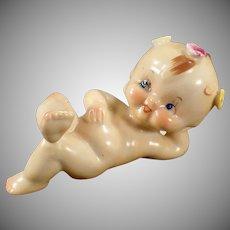 Vintage Porcelain Figurine - Reclined Kewpie-Like Baby with Flowers
