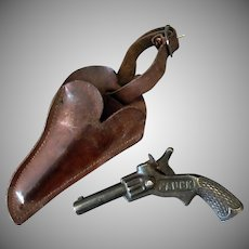 Vintage J.E.Stevens Cast Iron Pluck Toy Cap Pistol with Leather Holster